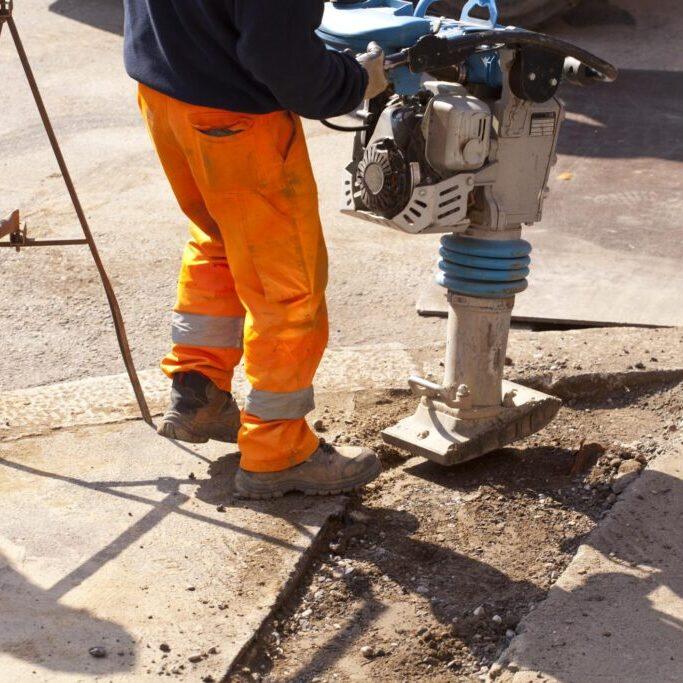 man drilling the floor