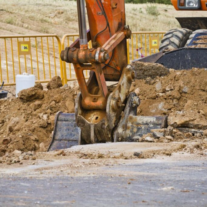 an excavator truck digging a hole